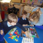 We are sorting dinosaurs by colour and dinosaur type.